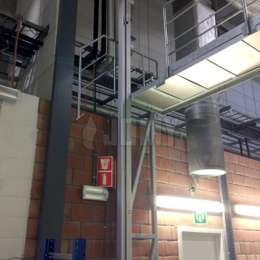 JOMY access ladder used for industrial platform and machine access in a factory with little space.