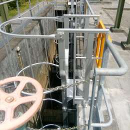 Cage ladder used to go down a well in a water treatment facility.