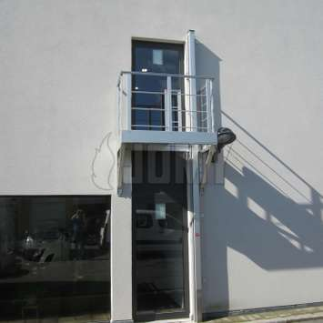 Access balcony situated above a door, with a JOMY retractable ladder.