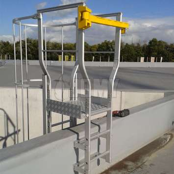 Custom made cage ladder roof landing for parapet crossing.