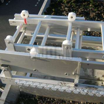 Close-up of the supporting frame and roller-guides.