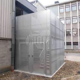 Enclosed staircase in aluminium with perforated panels and security door.