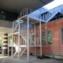 Fire escape staircase in aluminum for an office building.
