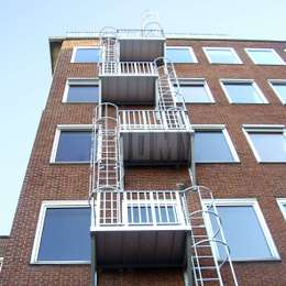 Cage ladders and balconies used for the evacuation of a medium-rise apartment building.