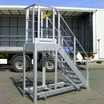 Mobile aluminium workplatform with access stairs, security gate and guardrails.