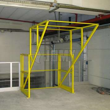 Pallet roll-over gate for truck loading.