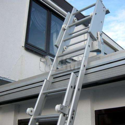 Deployed gliding ladder for roof fire escape.