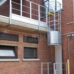 Roof ladder with cage, security door, gate and guardrails used for maintenance.