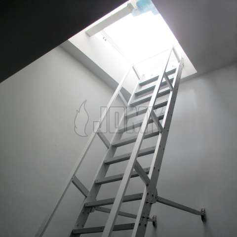 Counterblanced aluminium ship ladder used to access an industrial mezzanine.