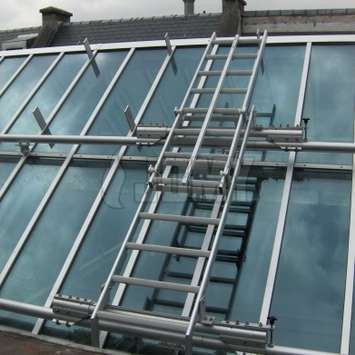 Sloped stepladder for window cleaning on roof - Building Maintenance Unit