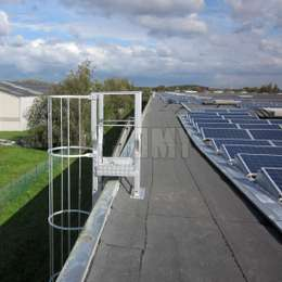 Roof ladder with cage used for solar panel access and maintenance.