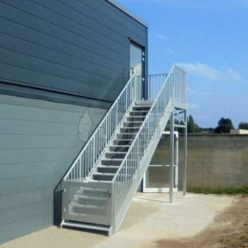 Stair guardrail with vertical tubes.
