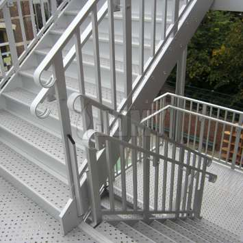 Handrails for both children and adults, mounted on the same evacuation stair.