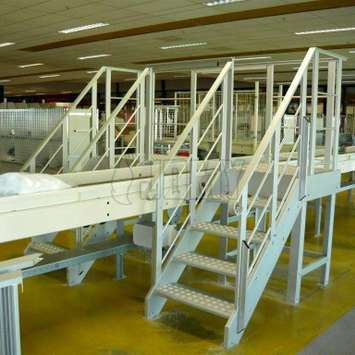 Crossover with parallel stairs on a production line.
