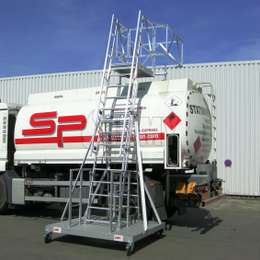 Mobile truck access system for working safely on top of any truck load or tank trailer. Mobile and height adjustable.
