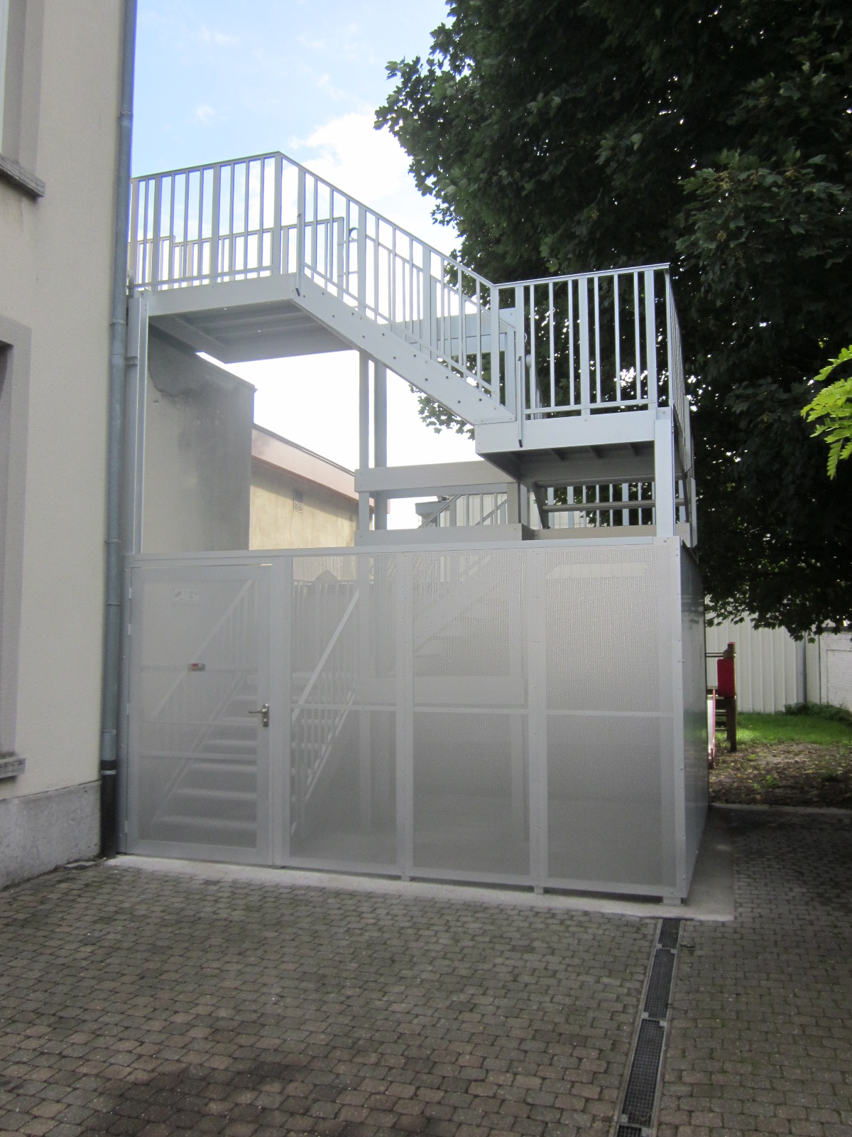 Caged stair entrance in anodised aluminum