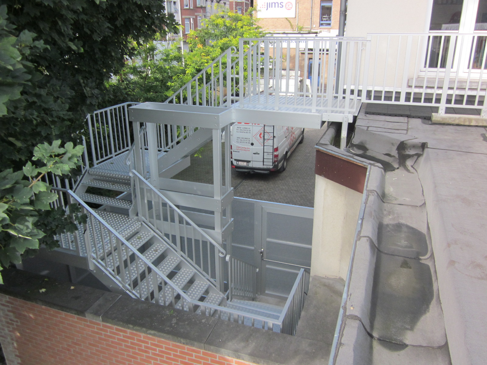 Crossed aluminum stairs with roof entrance