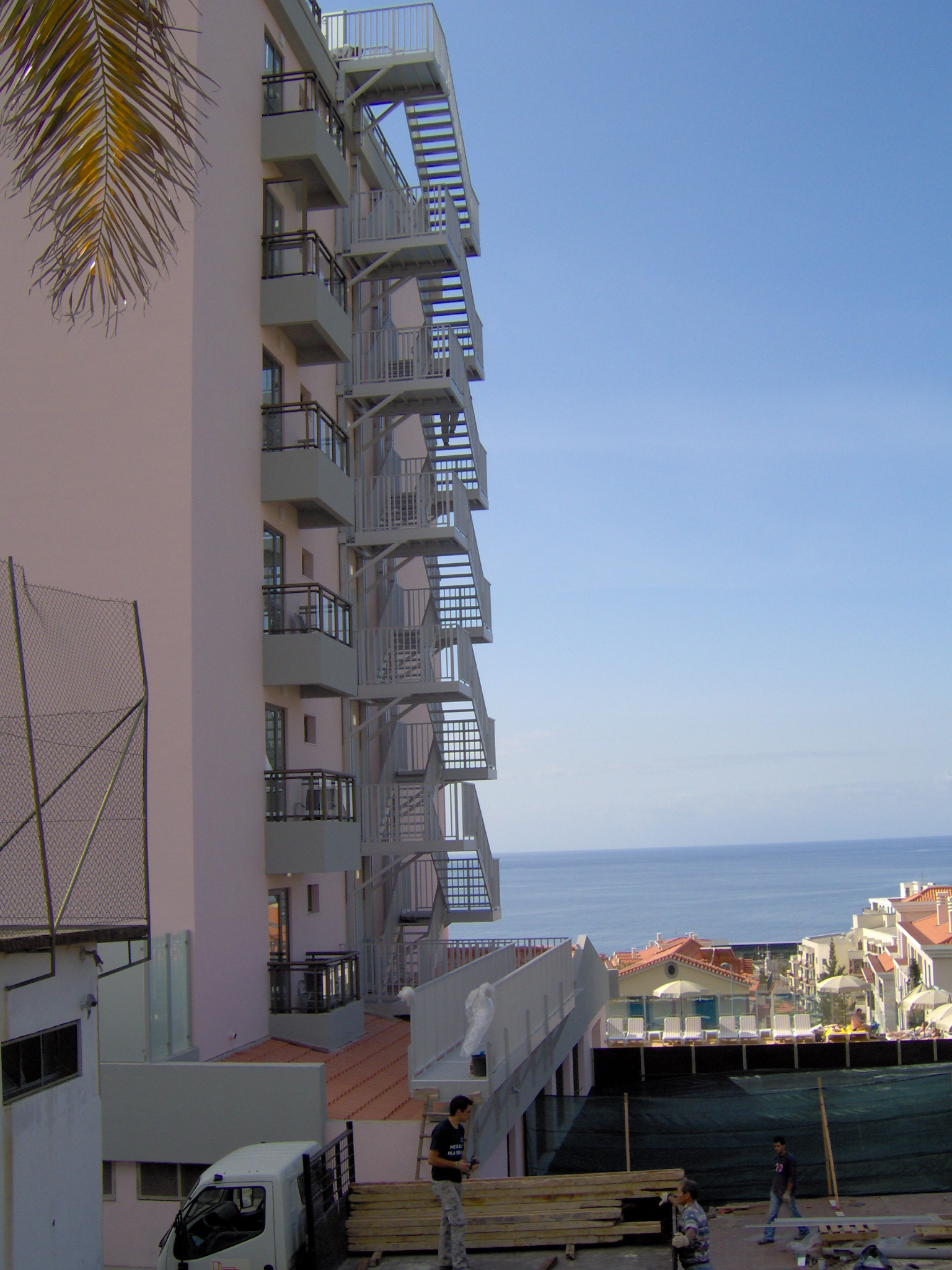 Fire escape stairs along the sea