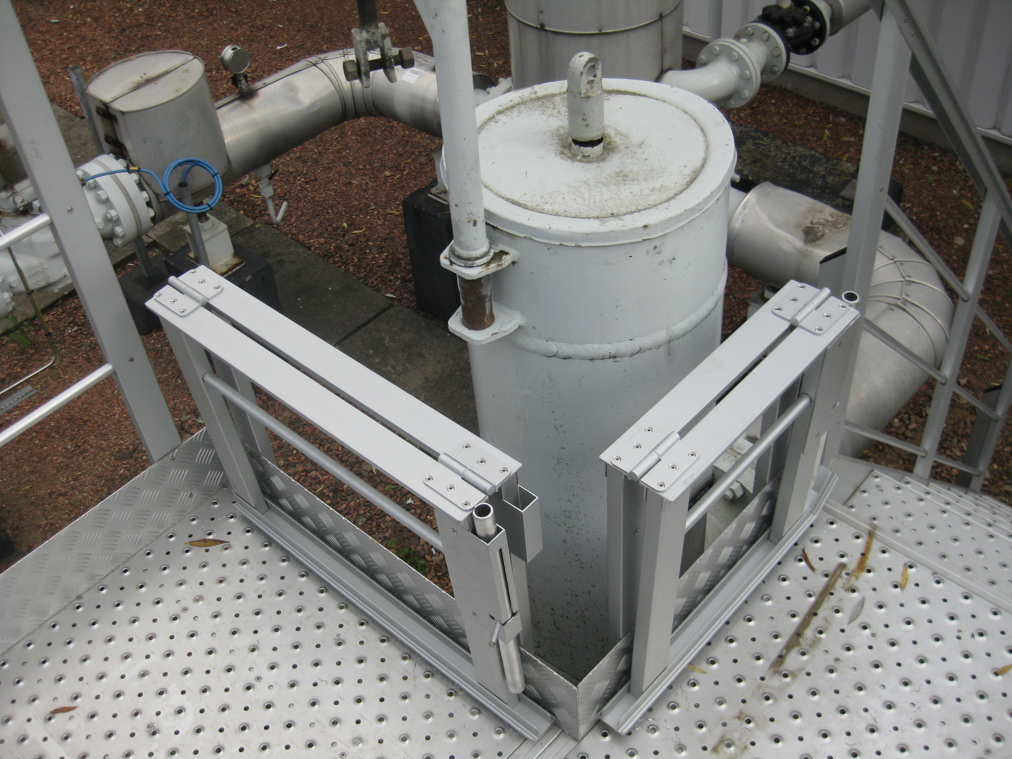 Guard rails around a filter in down position