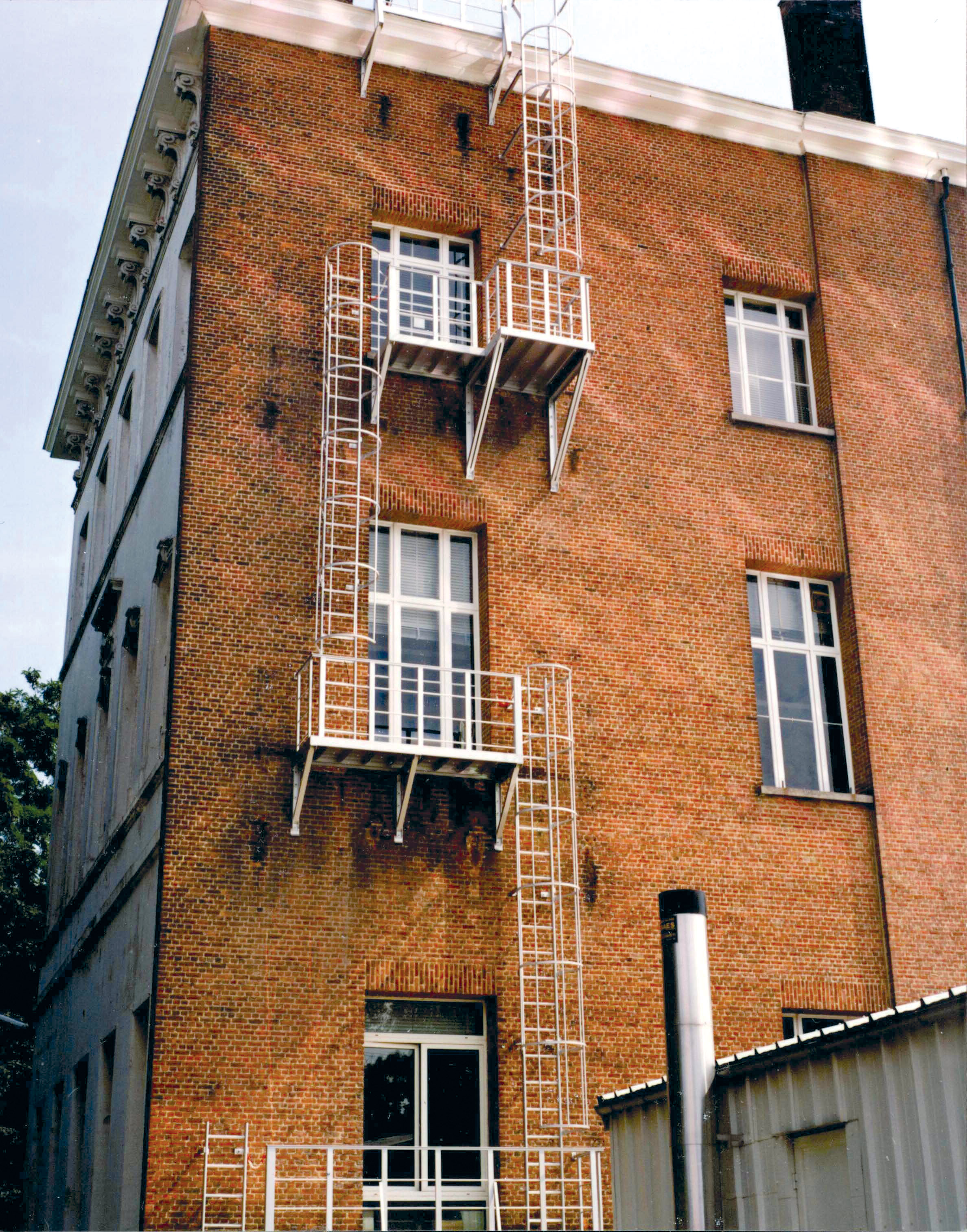 JOMY fire escape ladder. The most economic ladder is the fixed ladder with safety hoops according to regulations. For more then 40 years JOMY makes those ladders and adapts them to each specific situation.